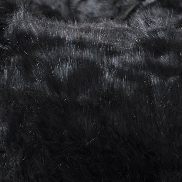 schwarzer Sesselhocker TiTAN S ist aus langhaarigem Fell